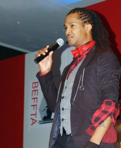 Award-winning international model trainer giving his acceptace speech at BEFFTA award at London Hilton Metropole