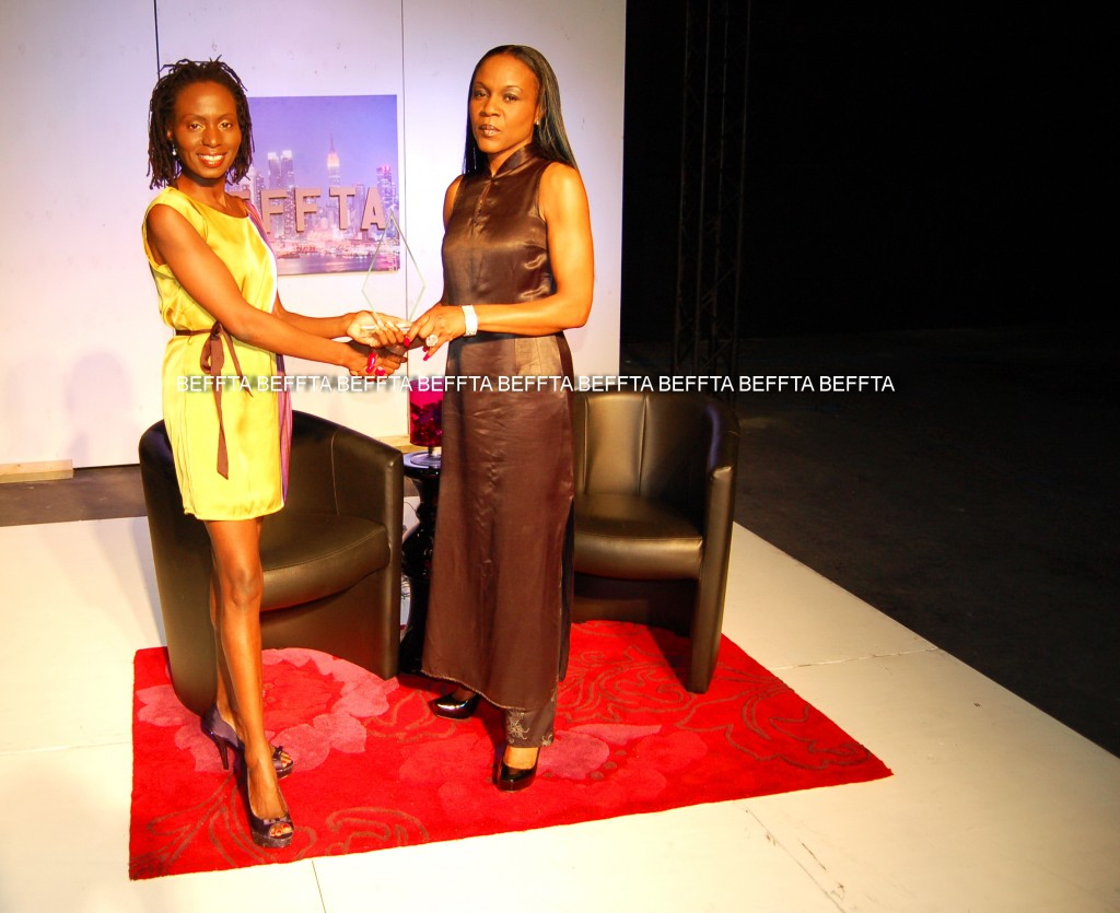 BEFFTA Creative Personality receiving her gong from Pauline Long on BEFFTA TV show