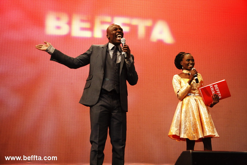 The king of comedy and co-host of BEFFTA UK 2012 Eddie Kadi and co-host and BEFFTA founder Pauline Long share a funny moment on stage