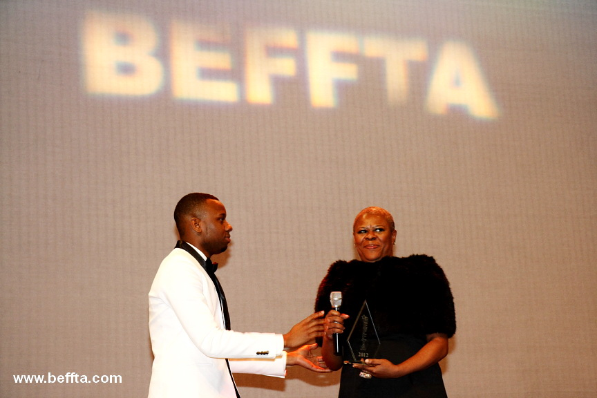RnB Superstar Starboy Nathan presents his mother Lorna Sutara Gayle with BEFFTA ENTERTAINMENT ICON AWARD 